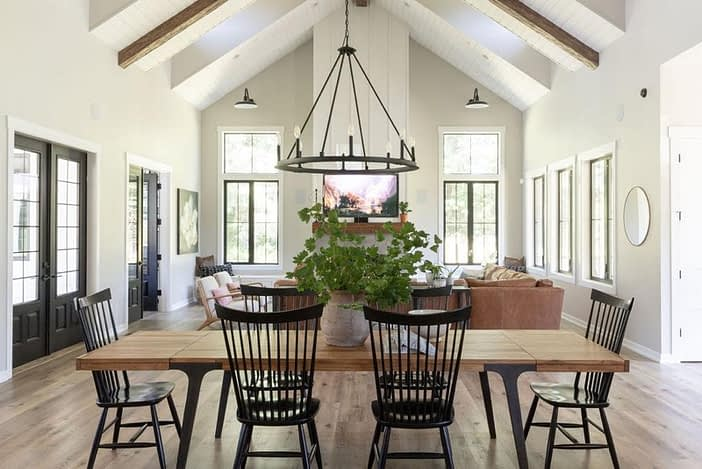 Modern Farmhouse dining table black chairs open concept space