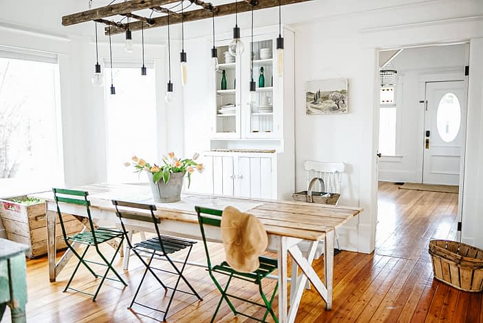 French Country Farmhouse Dinning Room with Antique Chairs and vintage table with white kitchen hutch