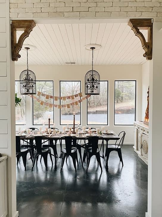 dinning room with black metal chairs industrial farmhouse