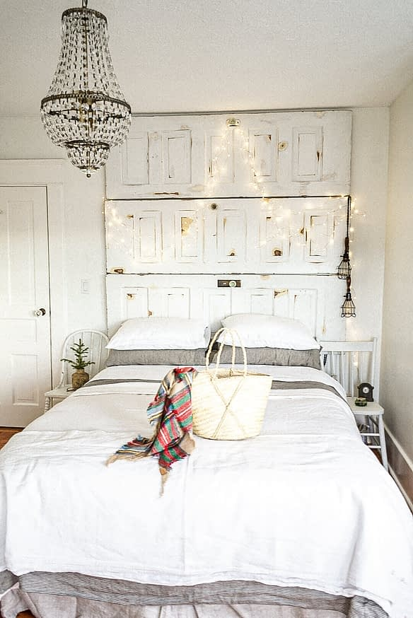 twinkle lights on head board with scarf on the bed