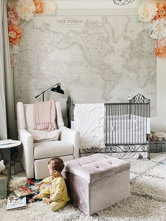 baby in the nursery playing on the floor