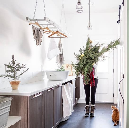 Brittany bringing in bundles of greenery for winter decor
