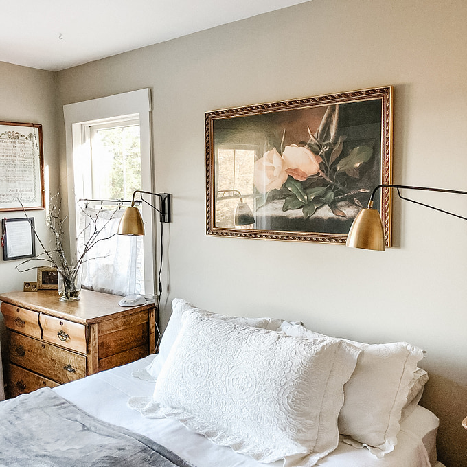 Marias bedroom copper patina bed side wall mount lamps white bedding farmhouse artwork