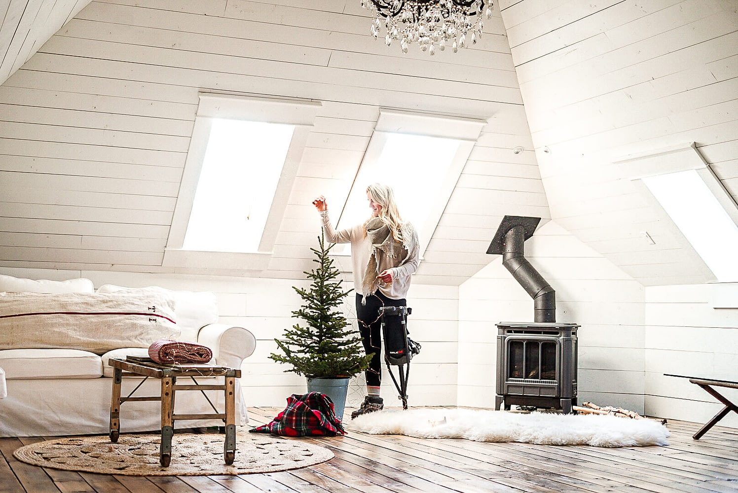 deb in the attic with twinkle lights