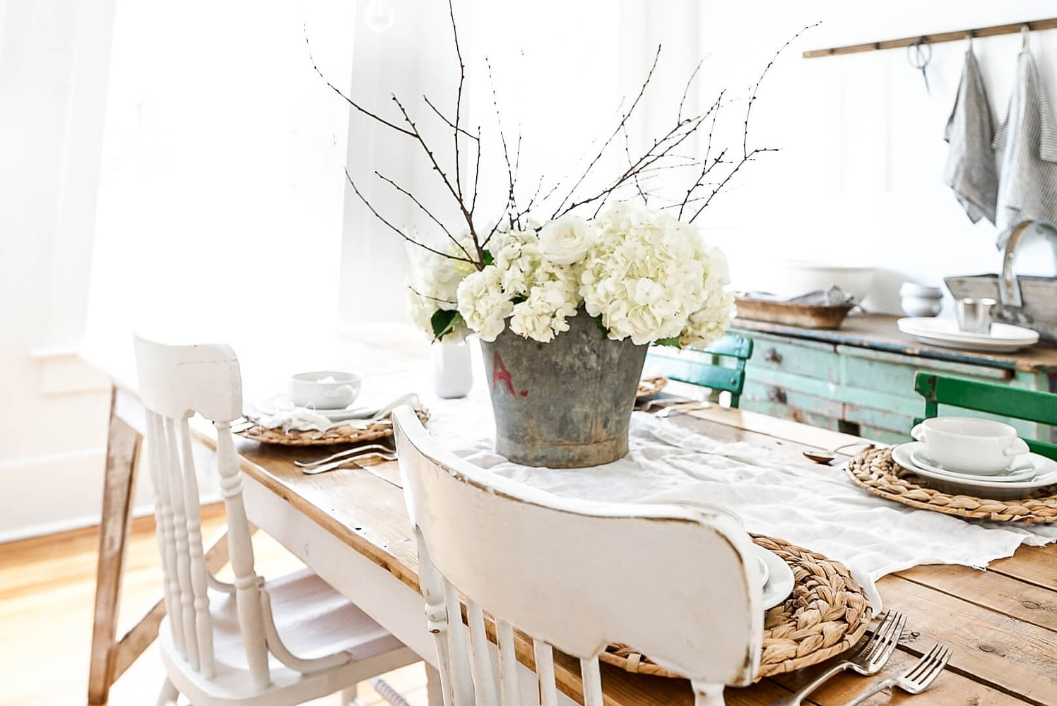hydrangeas and white decor on a table