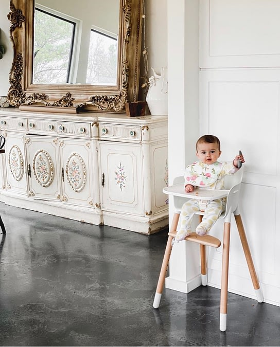 azure farm baby girl in high chair concrete floors white cabinets
