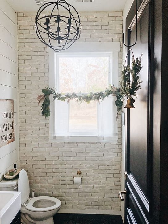 azure farm bathroom with a large window
