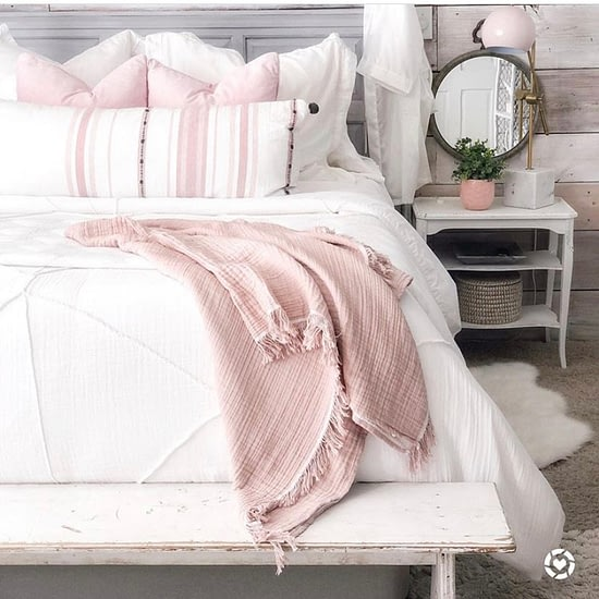 pink and white master bedroom ticking stripe pillows night stand decor