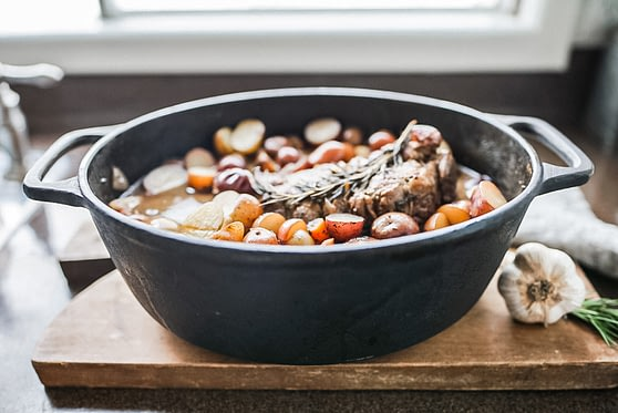 fall apart top round roast in cast iron pot on cutting board