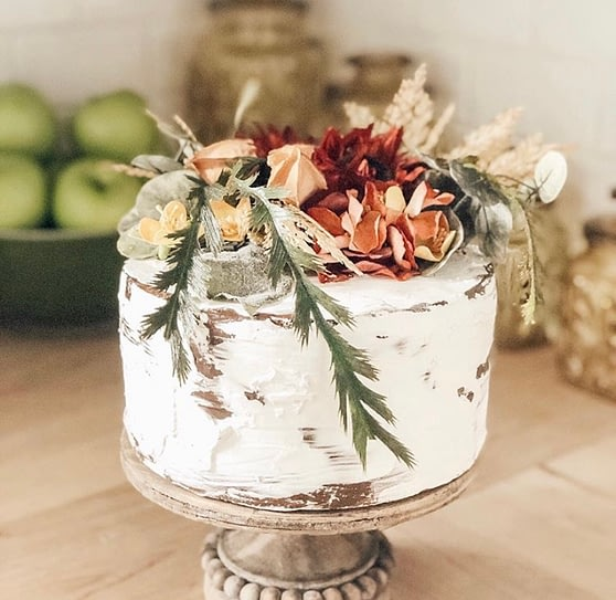 Fall decor on a rustic nearly naked cake