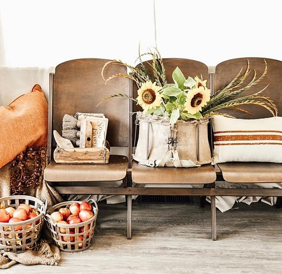 the curated farmhouse fall home decor home tour vintage folding bench apples in baskets sunflowers red ticking stripe