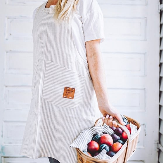 pinafore apron beige ticking stripe basket of apple redy for homemade apple juice