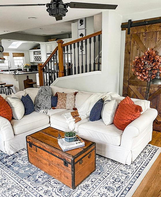 cozy farmhouse sectional living room white ikea couch blue and orange decor warm fall colours