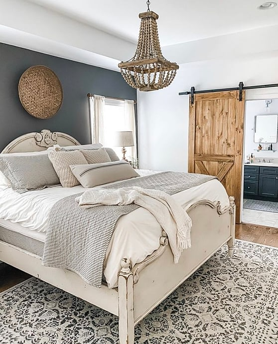 cozy master bedroom feature wall warm colours layers and texture wood tones