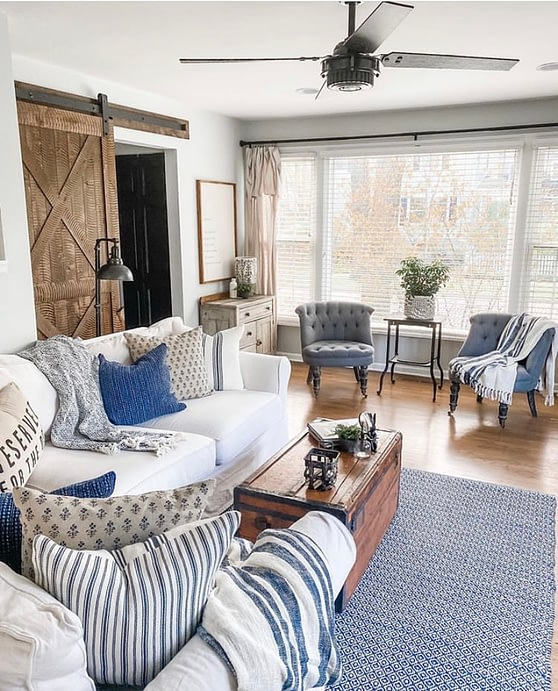cozy farmhouse sitting room blue and wood tones