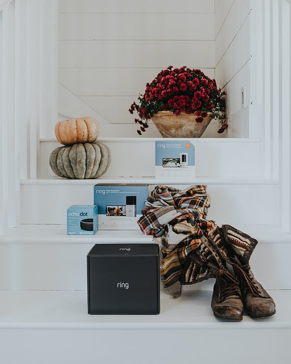 Best Buy Ring home Security system on staircase with boots and pumpkins