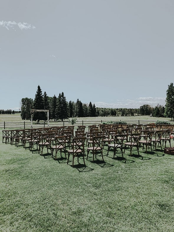 ceremony chairs set up for a backyard outdoor wedding in the country