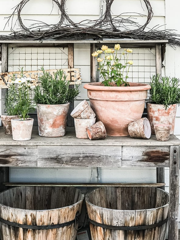 aging terra cotta flower pots potting bench whiskey barrels