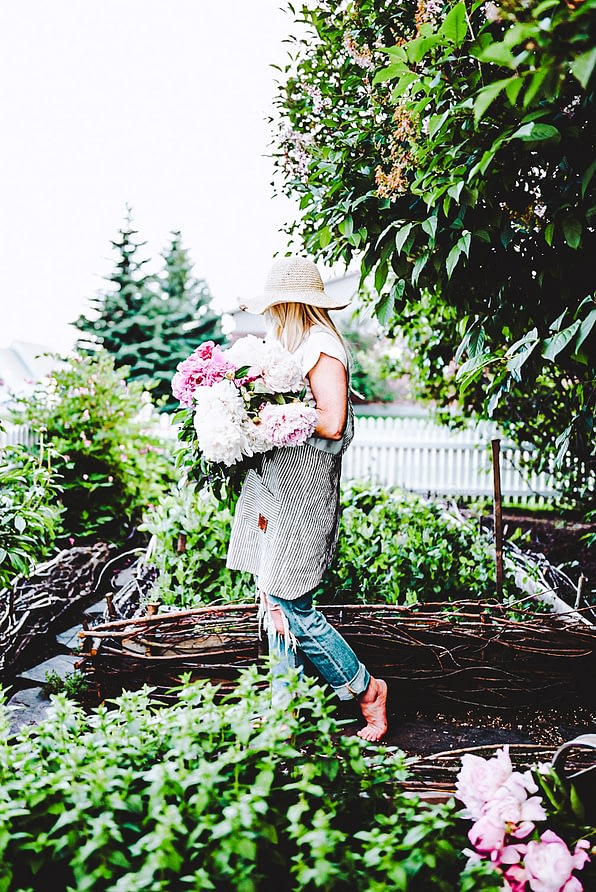 deb in the willow raised garden  harvesting peonies garden hat pinafore apron