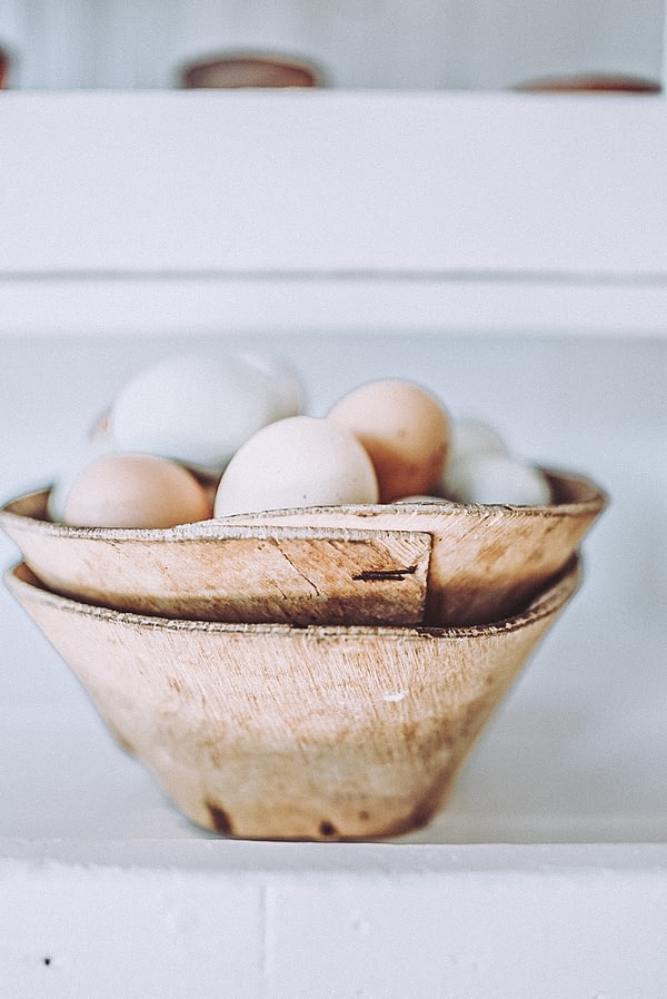 round balsa bowls stacked and filled with eggs