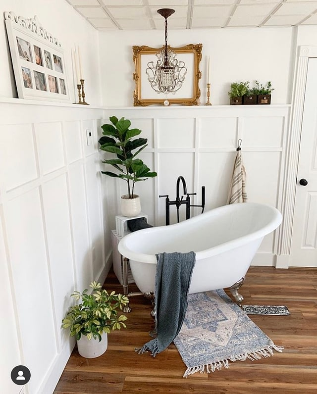 clawfoot tub in the corner of the antique farmhouse