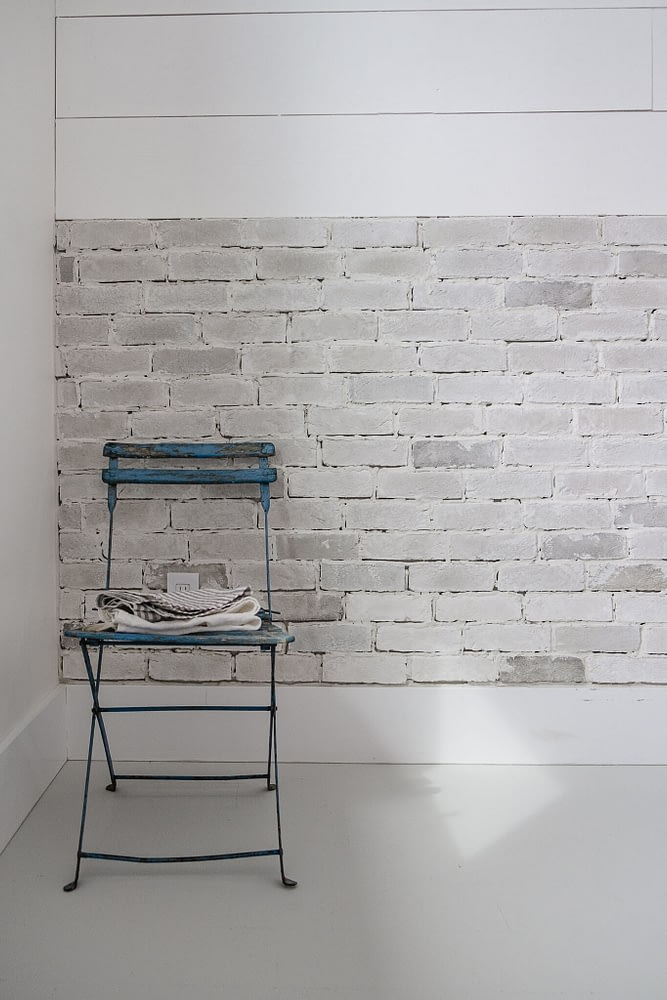 Thin Brick Wall Tutorial blue French antique chair with stack of linens