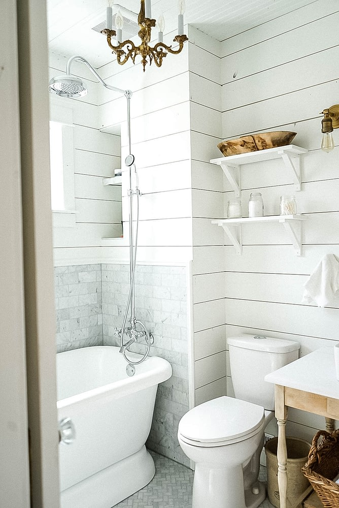 farmhouse bathroom with white shiplap and Carrera Marble tile