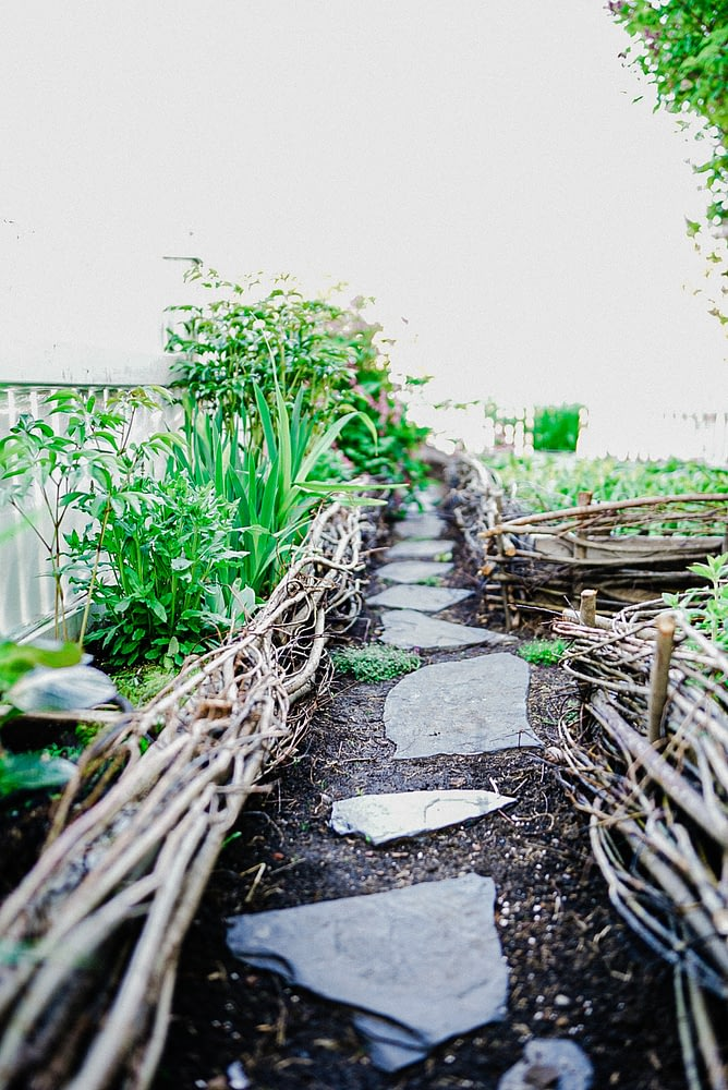 woven willow raised planter boxes stepping stone path