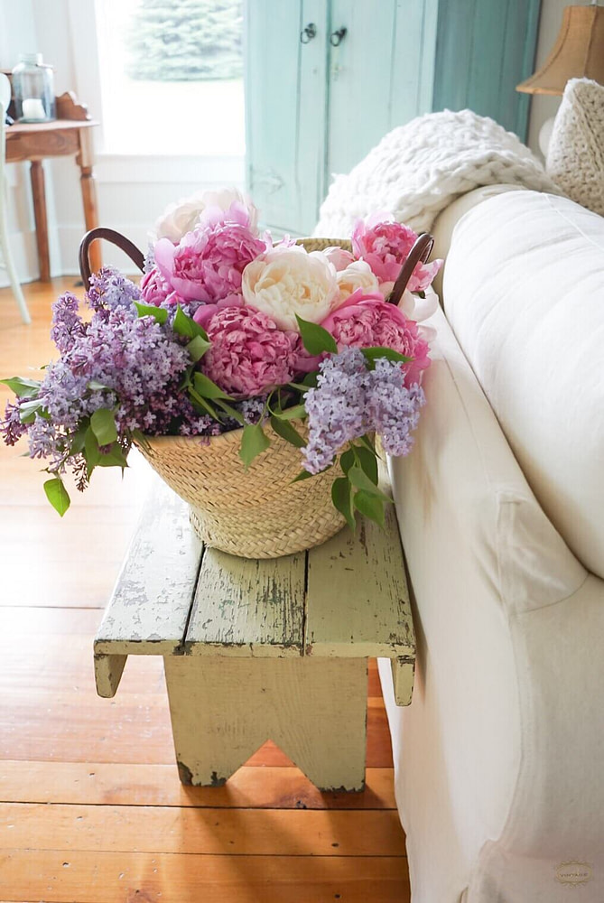 peony lilac flowers in market basket salvaged wood bench
