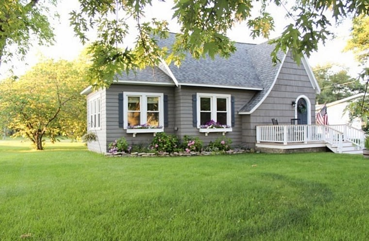english cottage style home exterior by pine and prospect