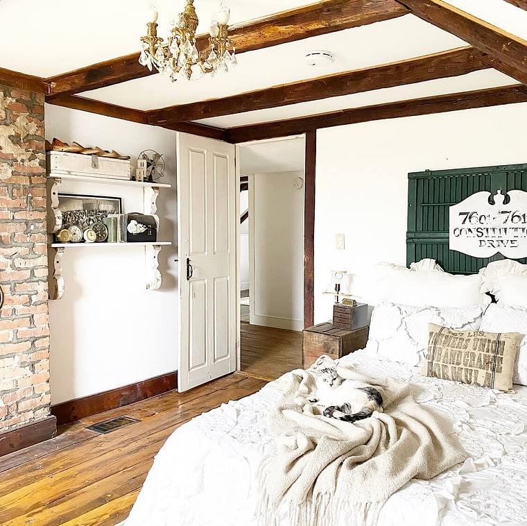 master bedroom farmhouse decor exposed beams and brick accents
