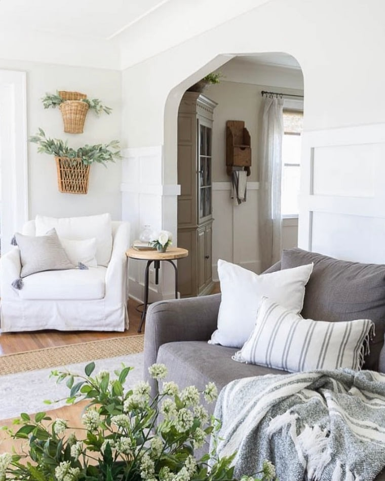 english cottage decor living space with neutral tones and arched entry ways