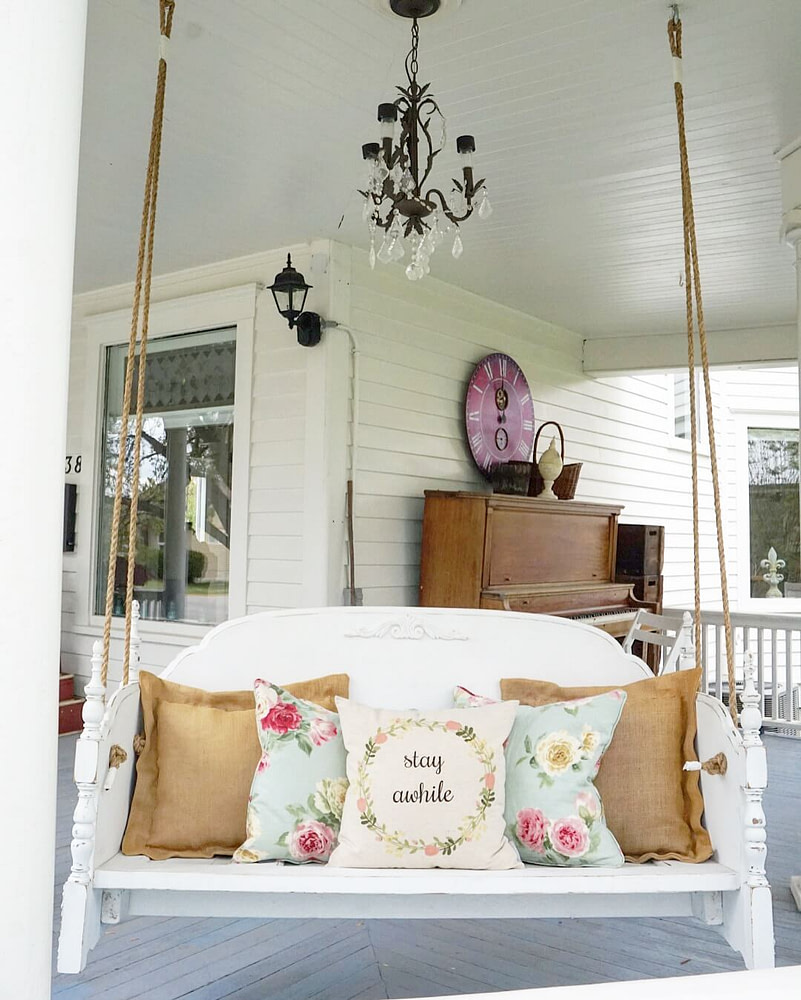 Full-View-Front-Porch-Swing-Bed-with-chandelier-piano