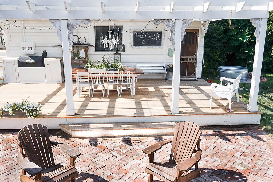 brick patio off the covered deck