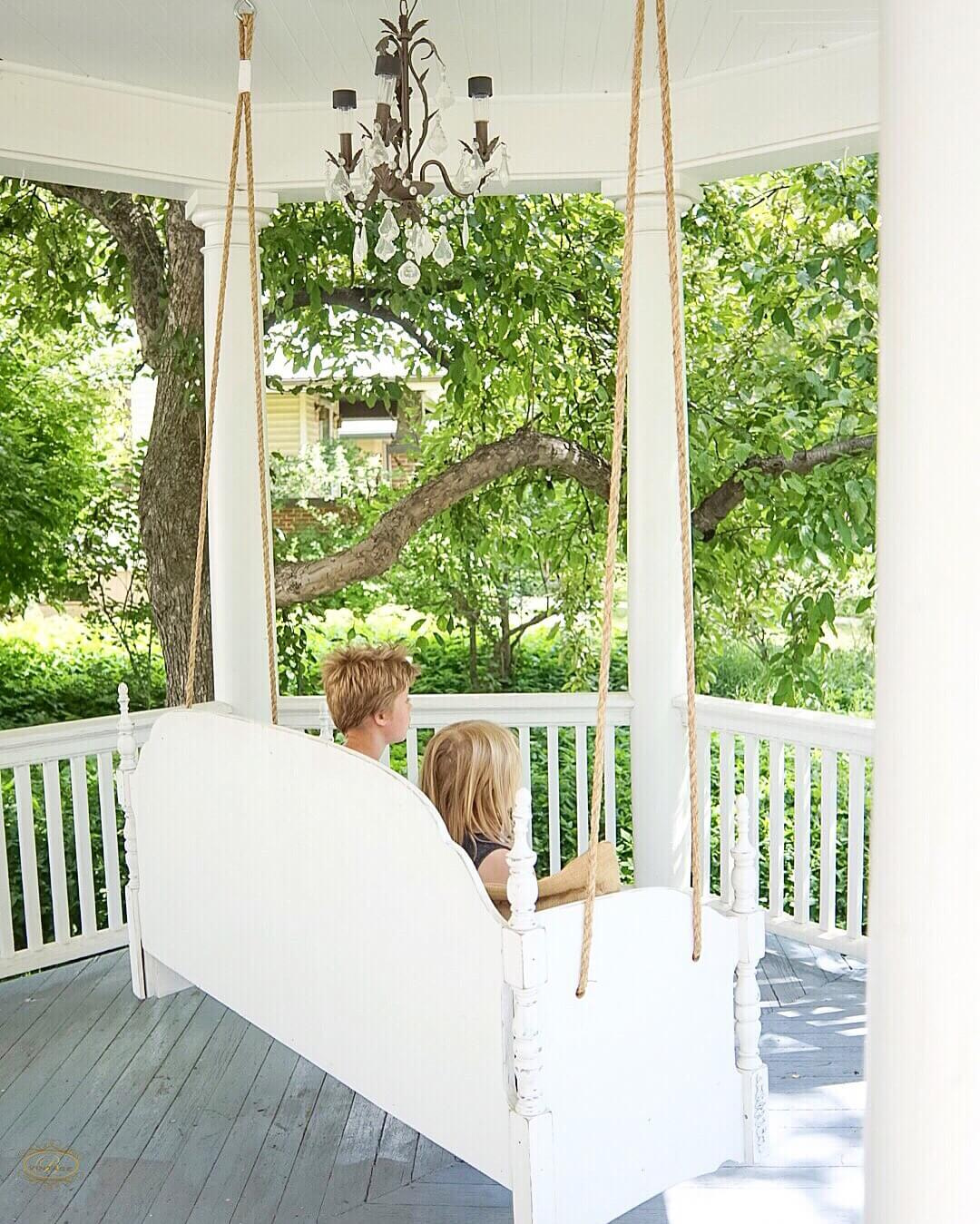Kids-Swinging-on-the-front-porch-swing-bed