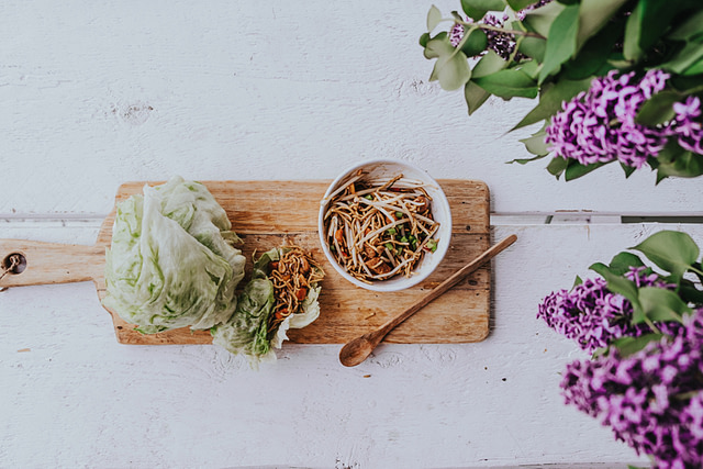asian lettuce wraps on cutting board petite wooden spoon