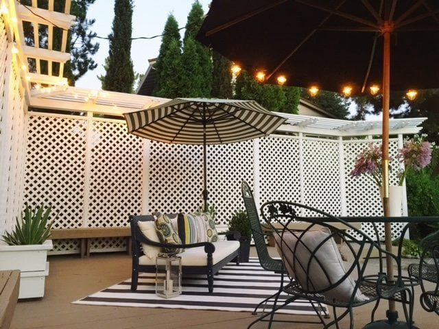 cozy back yard patio idea with large umbrella and patio couch black and white design