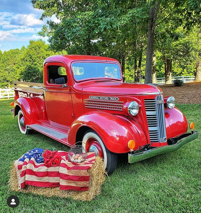 vintage red truck straw square bale with American flag and egg basket