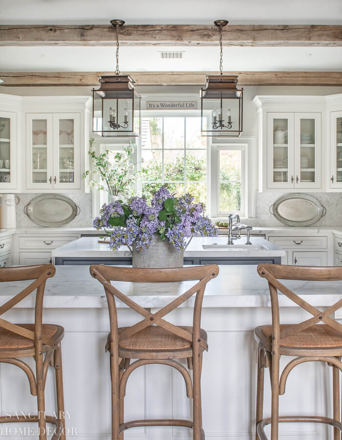 Rustic Farmhouse Kitchen Island with lilac centrepiece by Sanctuary Home Decor