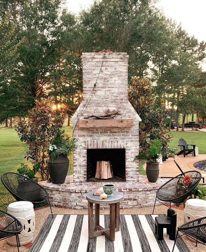 outdoor freestanding fireplace entertaining space